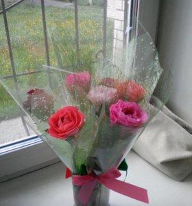Цветы с конфетами внутри.