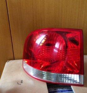 Фонарь левый внешний Touareg 7L6945095L