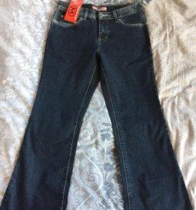 Новые джинсы клёш.