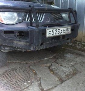 Продам б/у силовой бампер на Л200