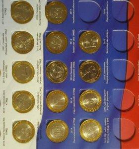 Коллекция бимметалических монет в альбоме
