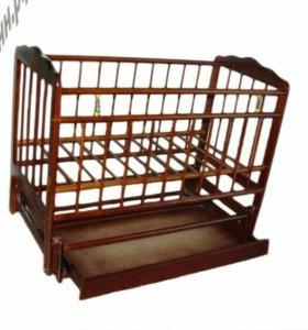 Кроватка детская с маятником и ящиком