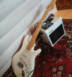 Гитара с усилителем.
