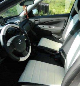 Чехлы на любое авто для Nissan almera