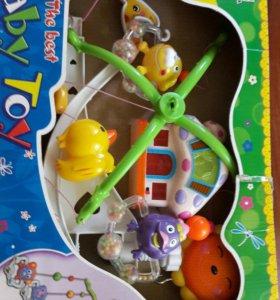Детская игрушка музыкальная карусель