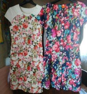 Платья новые много
