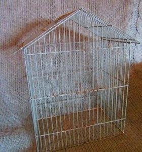 Металлическая клетка для птиц
