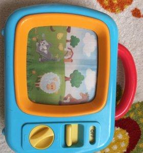 Детская игрушка музыкальный телевизор