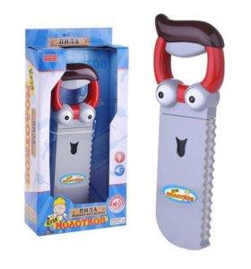 Детская игрушка со звуком пила