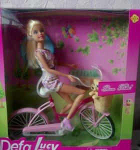 Кукла на велосипеде новая