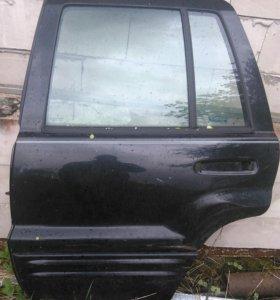 Задняя левая дверь Jeep Grand Cherokee