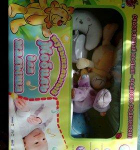 Мобиль на кроватку с мягкими игрушками.