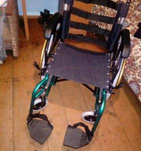 Инвалидное кресло.