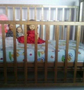 Детская кроватка-маятник.