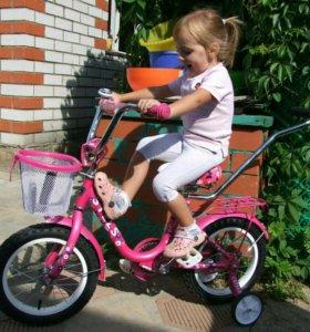 Велосипед Стелс с родительской ручкой