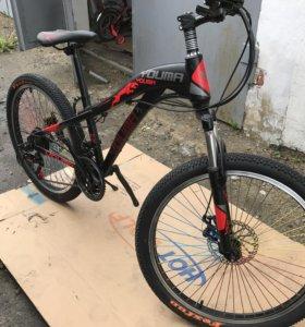 Новый горный велосипед.