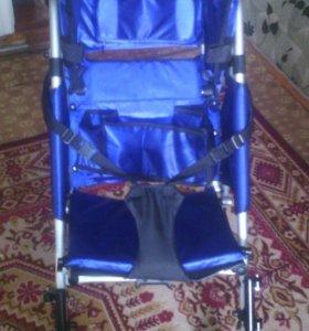 Инвалидная детская коляска
