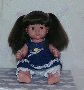 Немецкая фирменная кукла с роскошными волосами.