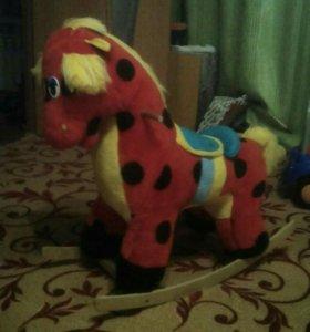 Детская игрушка качалка