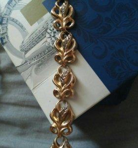 Золотой женский браслет.