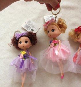 Куколки брелочки новые в ассортименте.