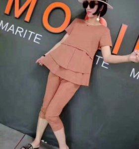 Стильный модный женский костюм.