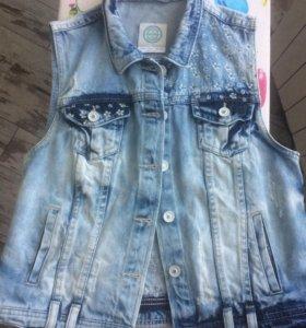 Продам жилет джинсовый