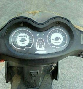 Макси скутер.