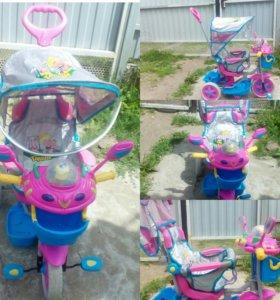 Велосипед детский трёх колёсный с ручкой.