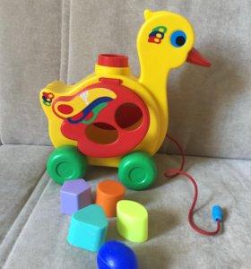 развивающая игрушка уточка на веревке
