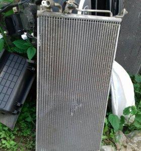 Радиатор кондиционера на lanser 9