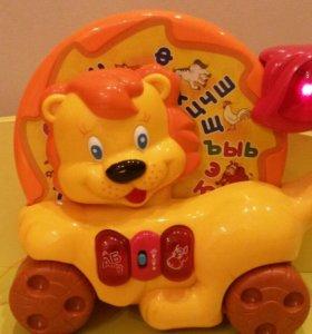 Музыкальная игрушка каталка Львёнок joy toy