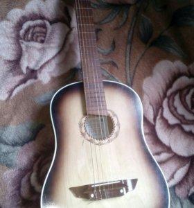 Акустическая гитара с нейлоновыми струнами