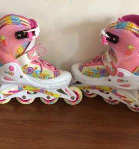 Раздвижные роликовые коньки для девочки.