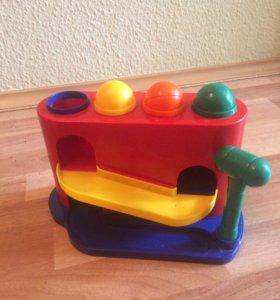 Развивающая игрушка стучалка