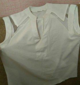 Блузка без рукавов.