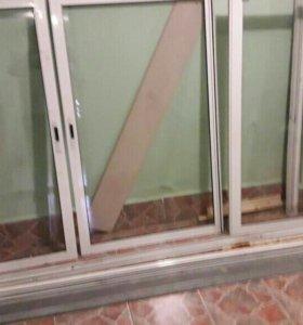 Остекление балкона б/у. Размер рамы 247x142см.