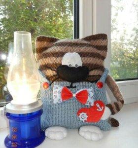 Кот подушка хранитель пульта