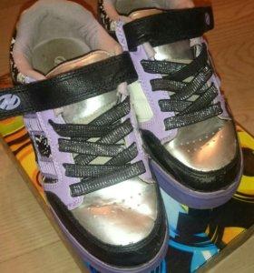 Кроссовки на роликах heelys