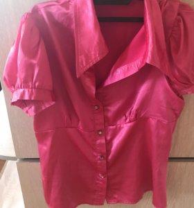 Розовая яркая блузка