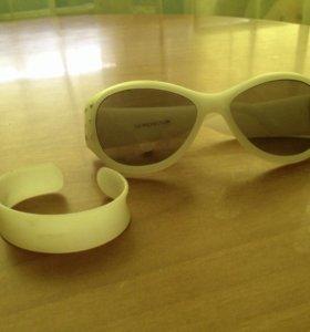 Солнечные очки и браслет