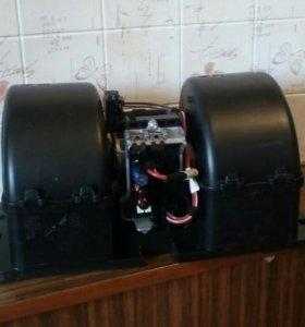 Мотор отопителя на MAN с крыльчатками.