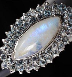 Кольцо лунный камень топазы