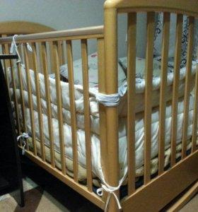 Детская маятниковая кроватка