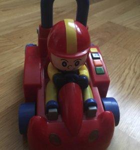 Машинка игрушка музыкальная