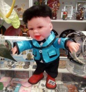 Танцующая кукла