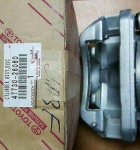 Суппорт тормозной оригинал Toyota 47730-26060