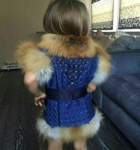 Меховые жилеты,пальто