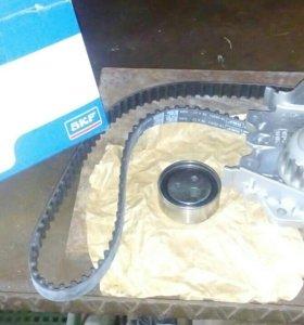Ремкомплект ГРМ с помпой для рено логан до 2009 г.