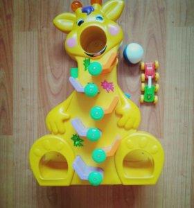 Музыкалтная игрушка жираф